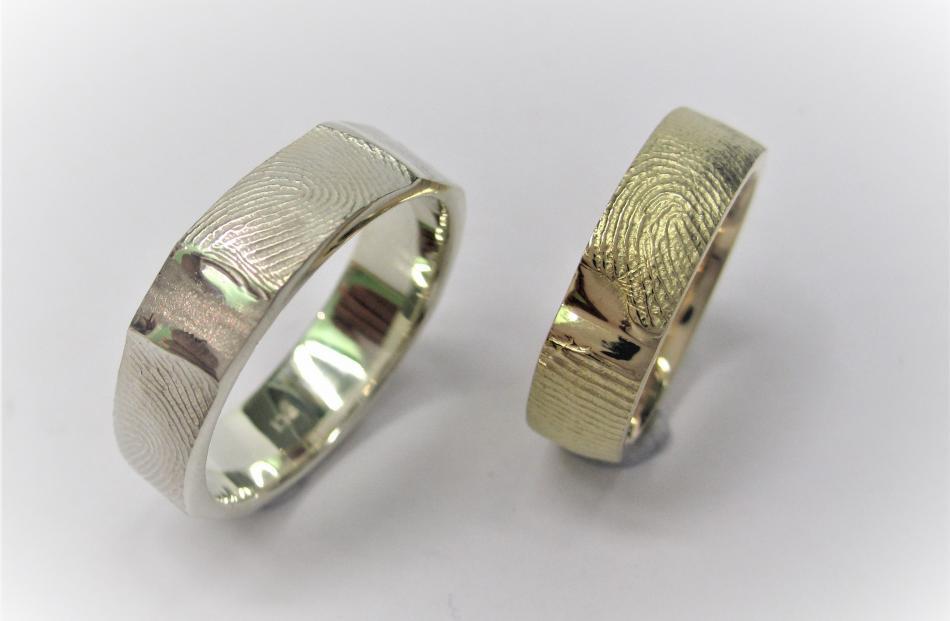 Fingerprint rings from Dunedin Goldsmiths.