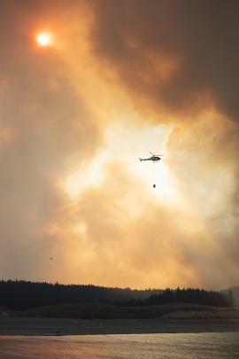 Helicopters fight the fire near Twizel. Photo: Murray Eskdale