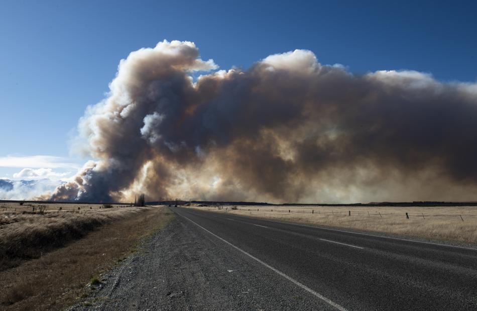 Smoke billows across the highway from the fire near Twizel. Photo: Murray Eskdale