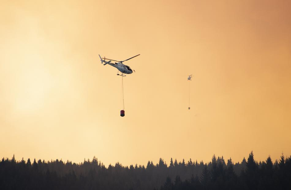 A helicopter fights the fire near Twizel. Photo: Murray Eskdale