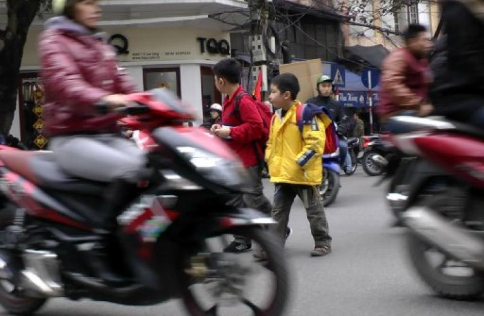 Crossing the street in Hanoi's Old Quarter  is adventure tourism at its most risky. Photos by D....