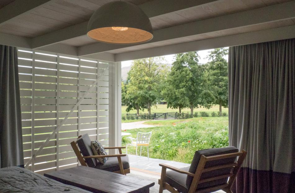 Sliding screens provide privacy and filtered light in one of the two bedrooms.