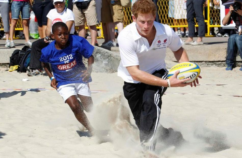 The prince plays beach rugby on Flamengo Beach in Rio De Janeiro. REUTERS/Suzanne Plunkett
