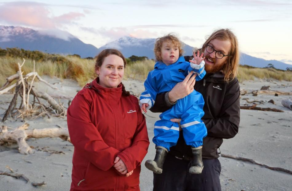 Sian (from left), Lucy and Vaughan Elder on Haast Beach.