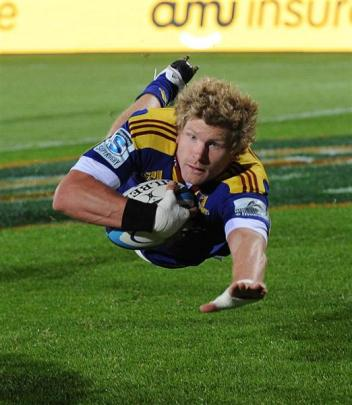 Flanker Adam Thomson scores a try against the Cheetahs at Carisbrook last year.