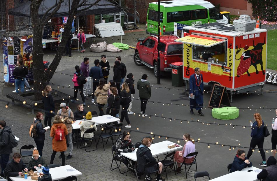 Patrons at the Food Truck Festival consider their options on the University of Otago lawn...
