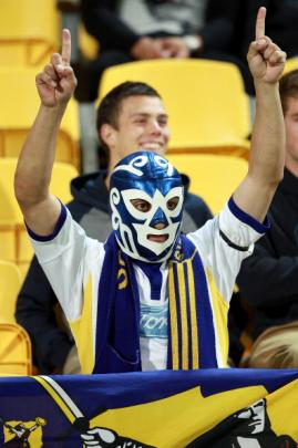 A Highlanders fan shows his support. (Photo by Hagen Hopkins/Getty Images)