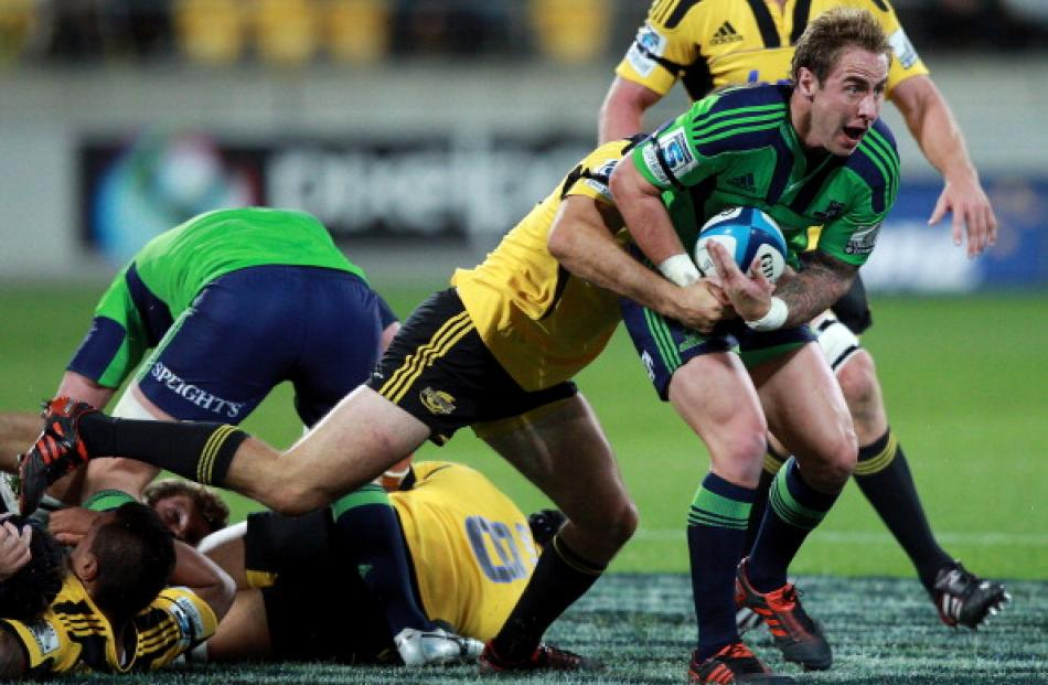Highlanders halfback Jimmy Cowan looks to clear the ball.  (Photo by Hagen Hopkins/Getty Images)