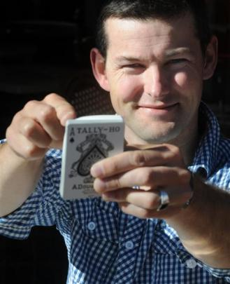 Mentalist Robert Haley plays his cards right in the Octagon yesterday. Photo by Craig Baxter.