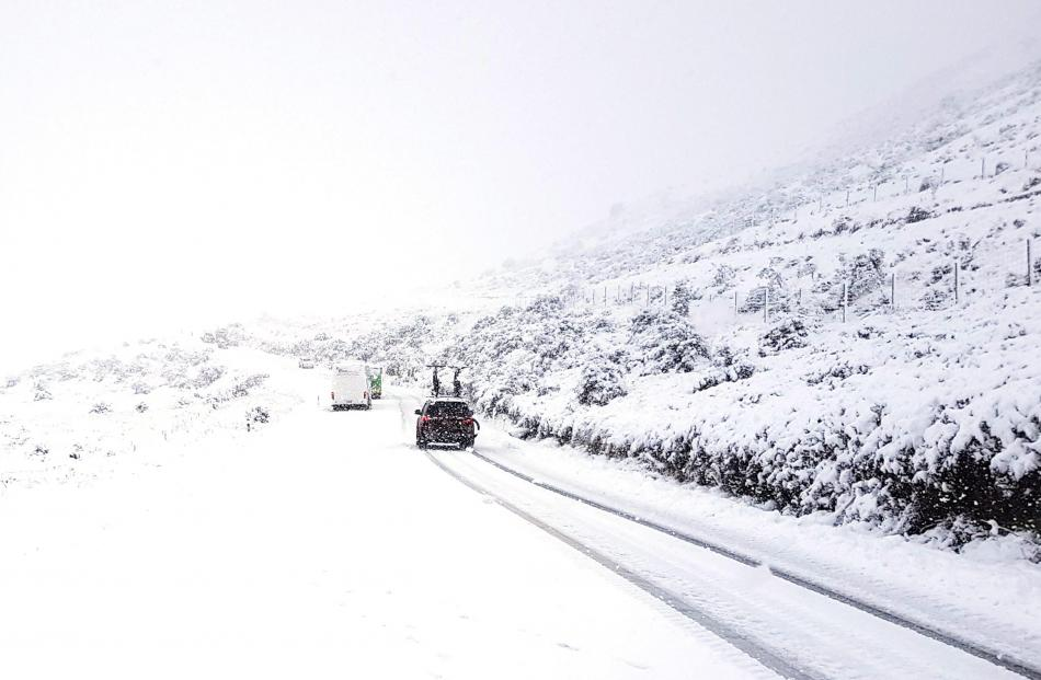 Vehicles were pulled to safety after getting stuck on SH94.  Photo: NZTA