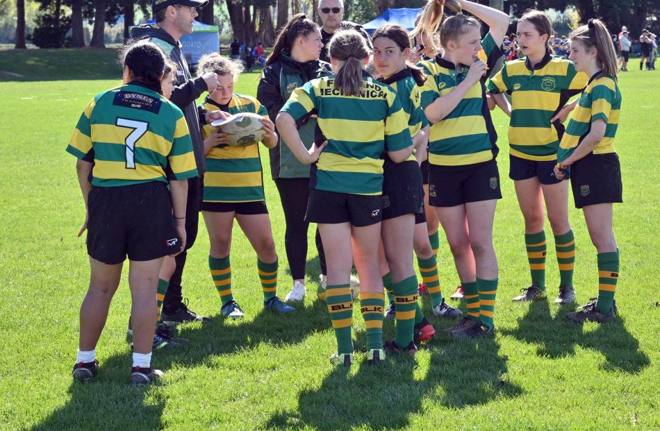 The Green Island Grizzlies under-13 girls team gets in a huddle to listen to coach Doug Hill....