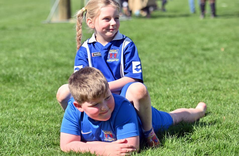 Sophie (4) and Cameron (8) McGrath enjoy the sunshine.
