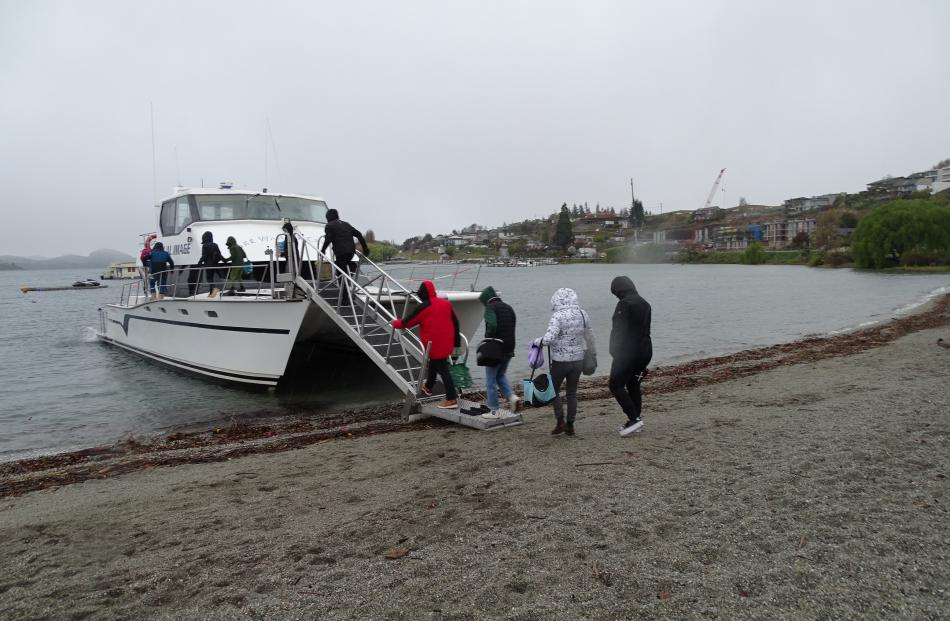 Rain, snow and freezing temperatures didn't tourists from boarding their cruise on the Dual Image...