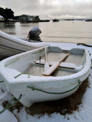 A snow-covered dinghy sits ashore at Oban on Stewart Island. PHOTO: NIK HURRING