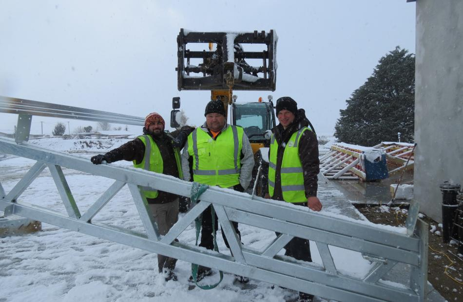 Staff from Nathan McDermott Building Ltd at the site of the new coolstore being built at T & G's...