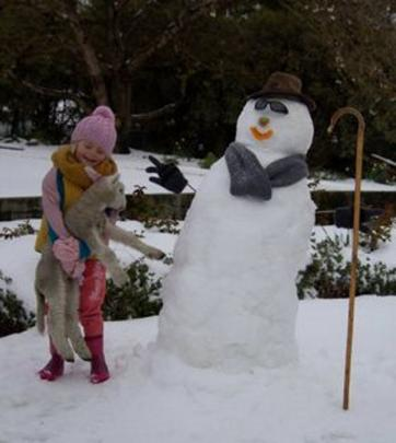 Caption: It was a special trip and first time in the snow for Chloe, who visited grandparents Deb...
