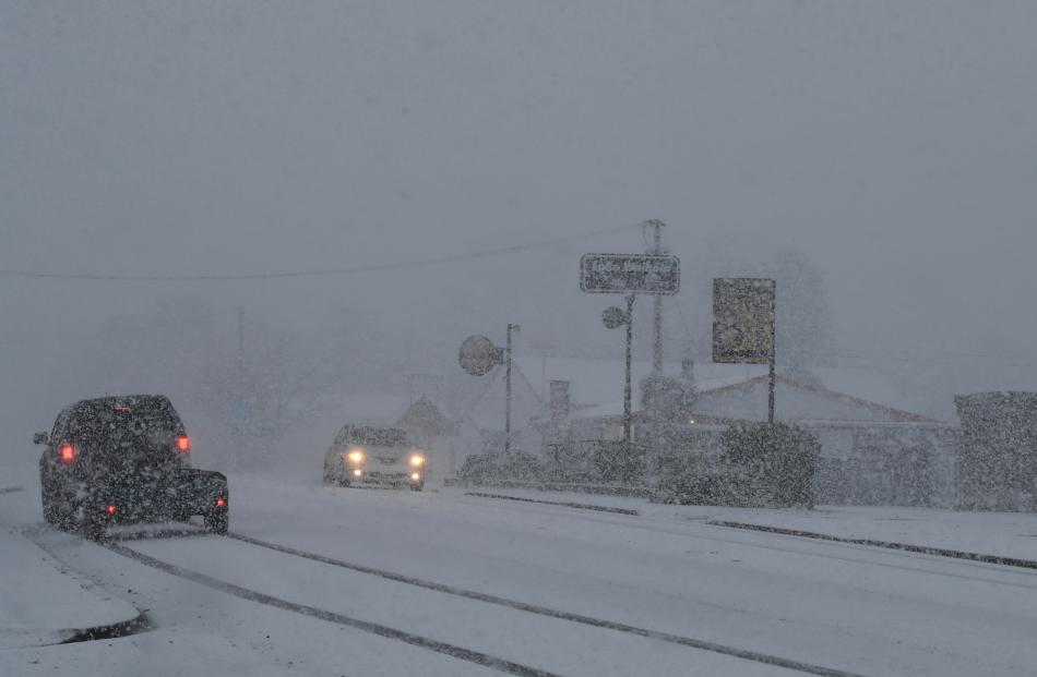 Snow made driving conditions difficult in Waihola this morning. Photo: Stephen Jaquiery