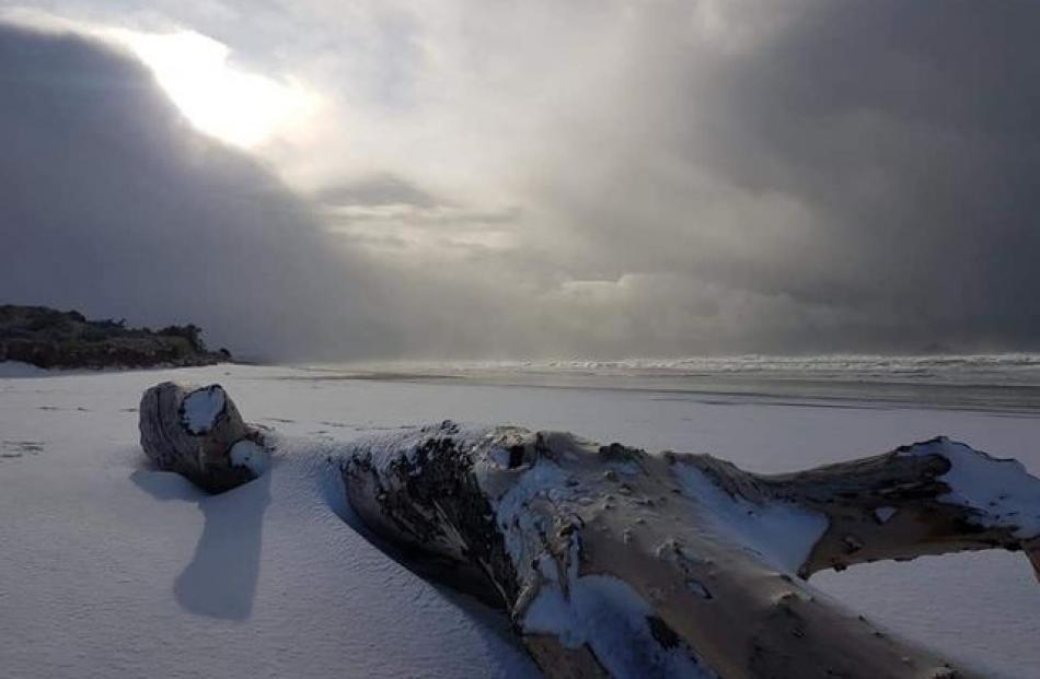 Even Brighton Beach had a dusting of snow this morning. Photo: Ashley Stewart