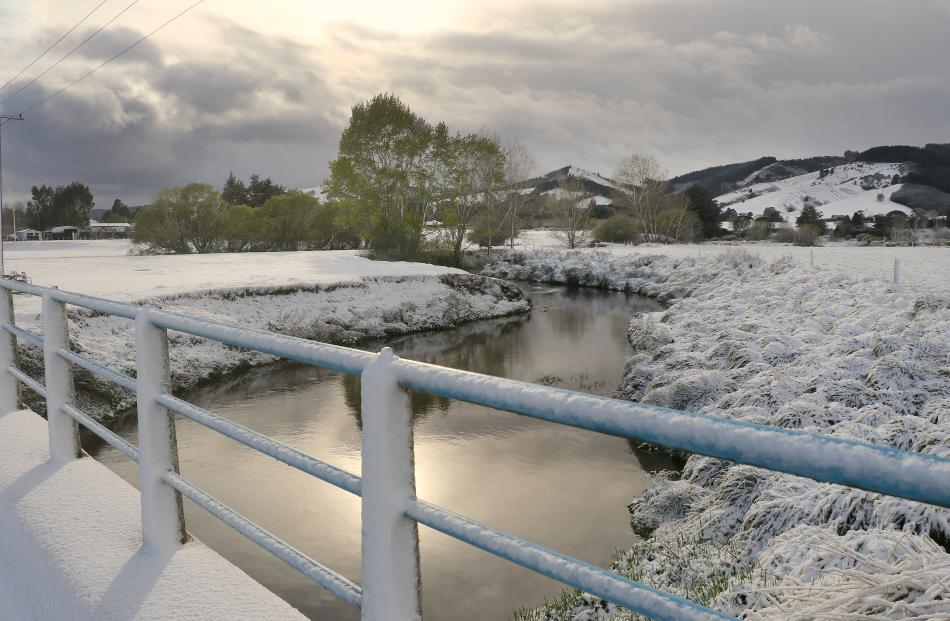 The sun peeks through a break in the snow storm to display the scenic beauty of the snow falls around the Milton area, this photo was taken on the Cochrane's Bridge east of Milton. PHOTO: JOHN COSGROVE