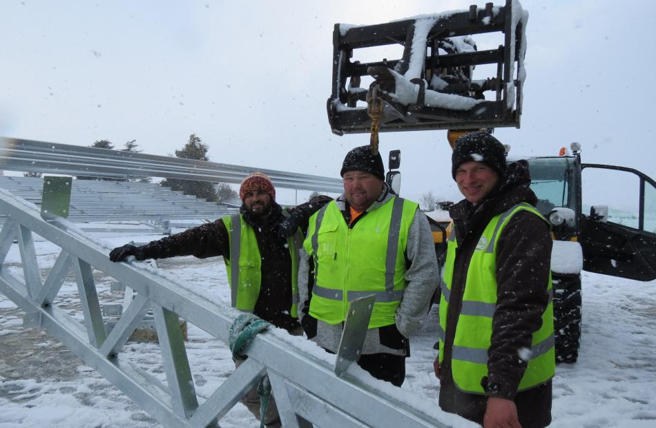 Jono McDonald, Nathan McDermott and Brayden Holden of Nathan McDermott Building Ltd work through the cold and falling snow to erect the steel framework for the roof of the new coolstore being built at T & G's Ettrick site. Photo: Yvonne O'Hara