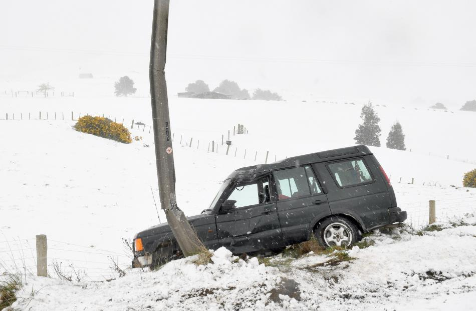 A power pole bore the brunt of a 4WD whose driver lost control in the icy conditions on the Owaka...