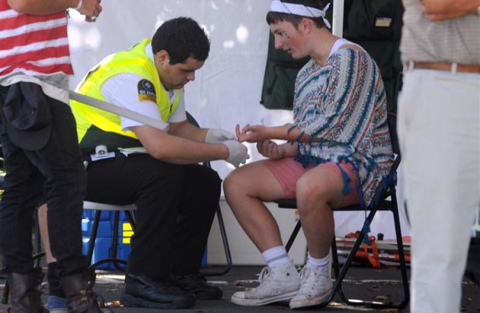 A St John staff member administers first aid to a  party-goer.