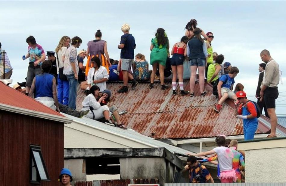 Revellers on the roof of John Leslie's property, part of which later collapsed.