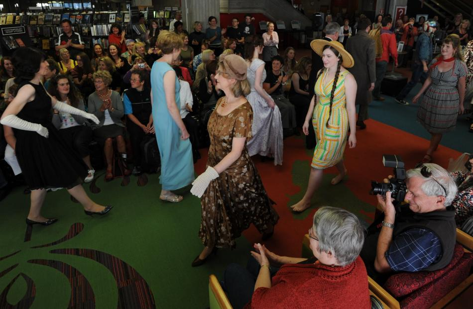 Models and library staff walk the grand finale at the show, part of the iD Fashion Week.