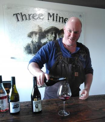 Paul Wright from Three Miners pours a glass of pinot noir.