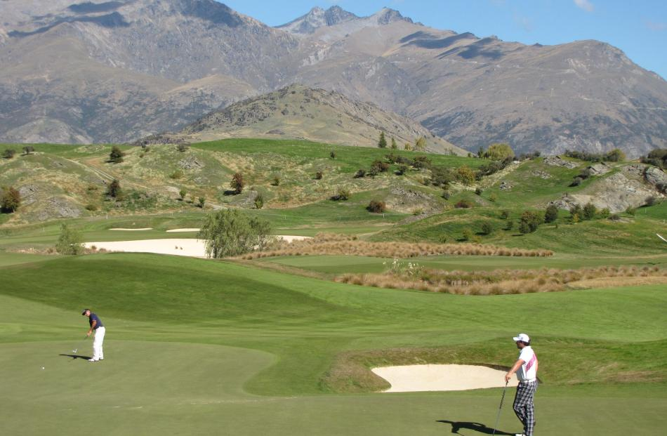 Golfers  play the 15th hole during the first day of the 2012 NZPGA Pro-Am at The Hills, Arrowtown...