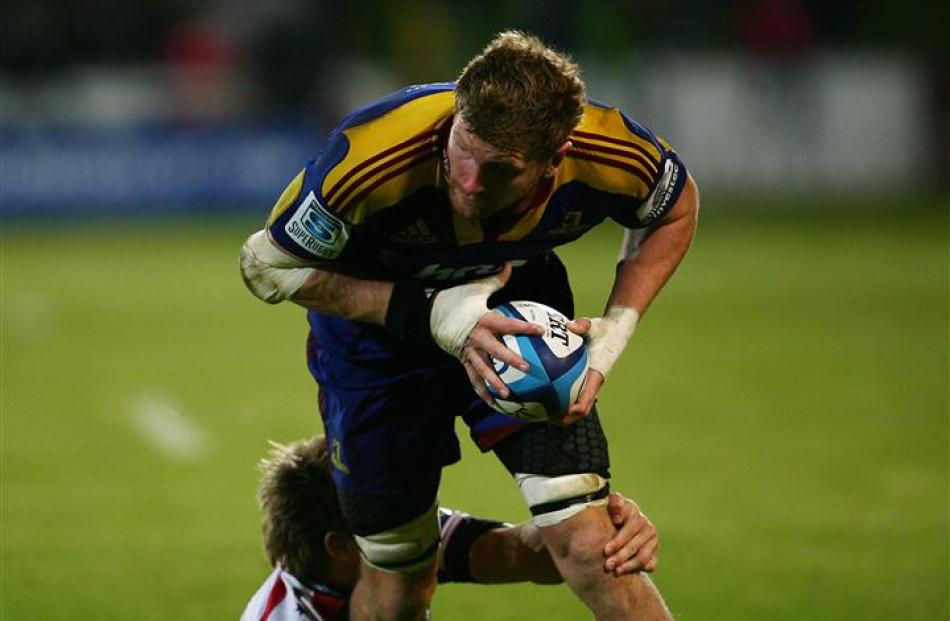Man of the match Adam Thomson is tackled.  (Photo by Teaukura Moetaua/Getty Images)