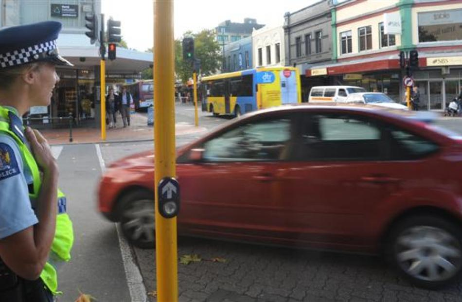 Police officers check on traffic and motorists' behaviour yesterday at Hanover and George Sts...
