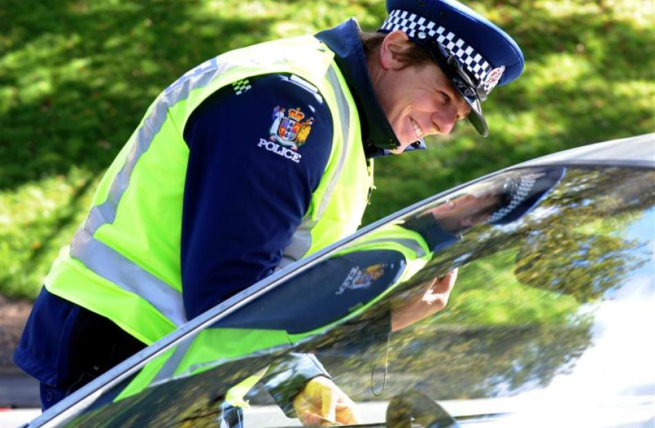Police officers check on traffic and motorists' behaviour yesterday on Princes St.