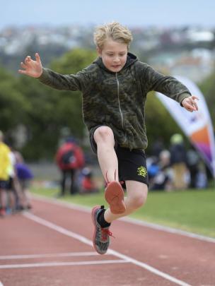 Zaydan Reynolds (8) soars in the long jump.