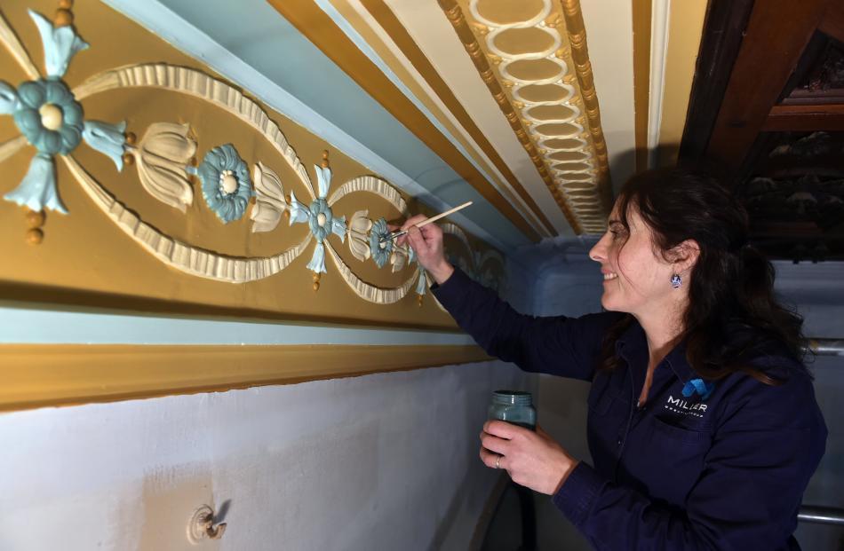 Miller Creative Group senior signwriter Corrina Woodason paints the breakfast room at Larnach...
