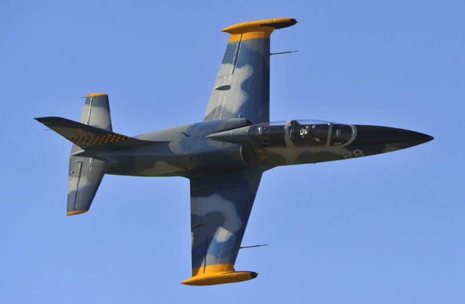 The Albatross L39, flown by Frank Parker, buzzes the runway at speed during Warbirds over Wanaka...