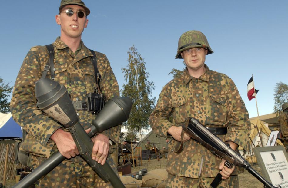 A pair of stern German army re-enactment enthusiasts  and their weapons at Warbirds over Wanaka...