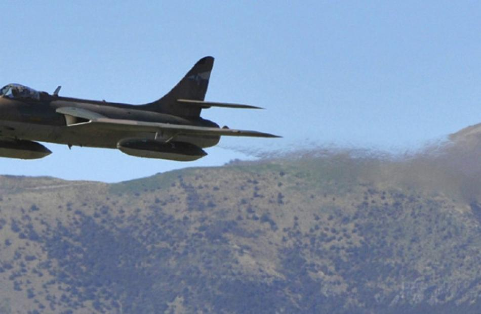 The Hawker Hunter FR74 screams past the crowd at low level on Saturday afternoon.