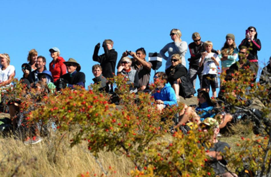 The large crowd gather on top of Mt Iron wANAKA to view the brand new Allblack Boeing B777 on...