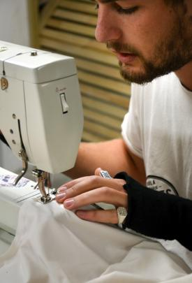 Richie Boyens sews on his Bernina 801 sewing machine at Above Ground. Photo: Emily Cannan