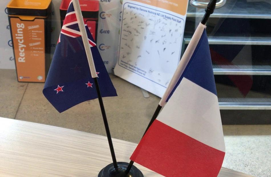 Twin flags in the Clydevale plant's reception area celebrate a successful French-New Zealand...