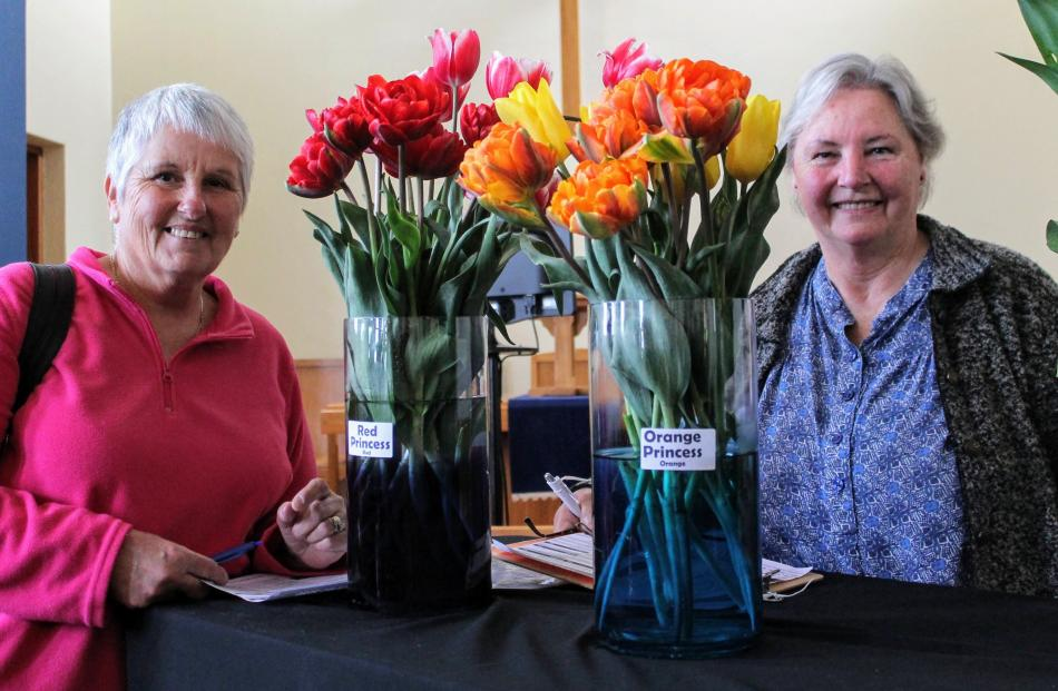 Jill Hill and Karen Brier select the tulip bulbs they will plant in their garden for next spring.