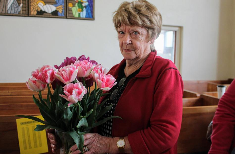 Event committee member Jean Kirby poses with her favourite tulip ''Foxtrot''