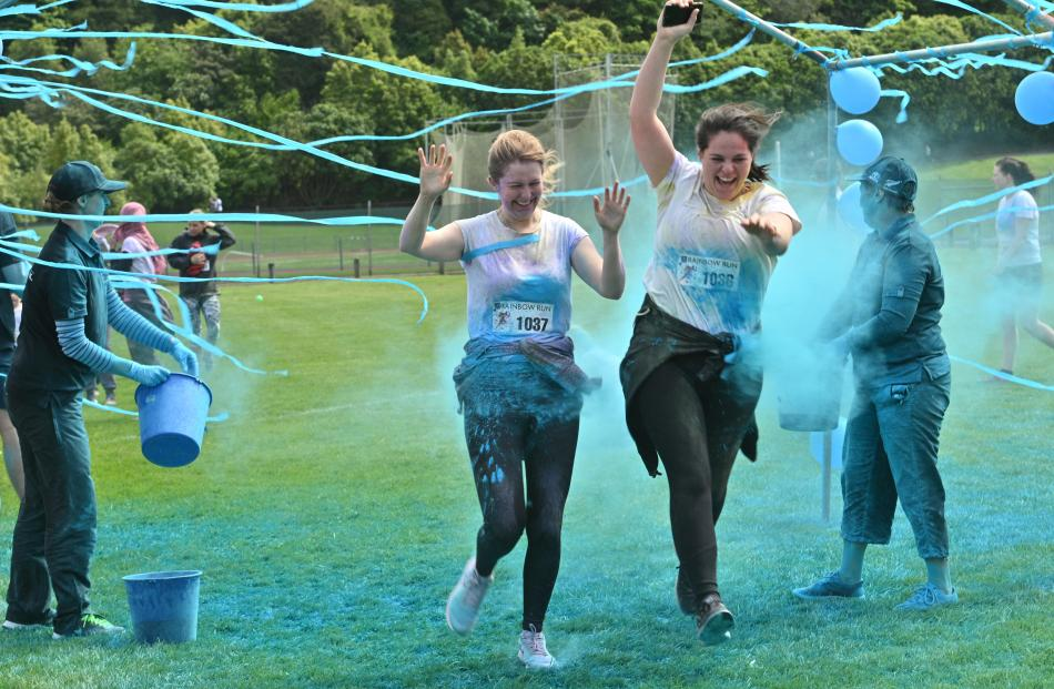 Kate Gidlow-Black (left) and Ruby Faragher run through a paint station. PHOTOS: LINDA ROBERTSON