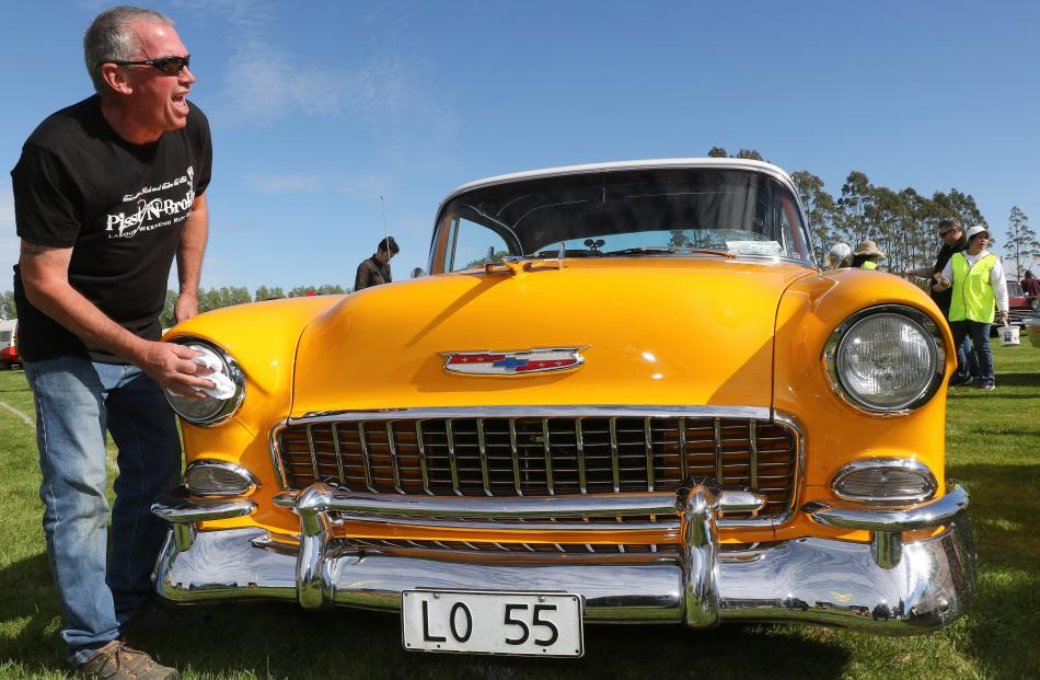 Peter Addis, a member of the Conrodders Rod and Custom Car Club of Dunedin, preps his 1955...