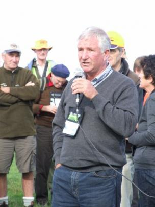 Robert Reid, of Verterburn, addresses the crowd attending a field trip to the property during the...