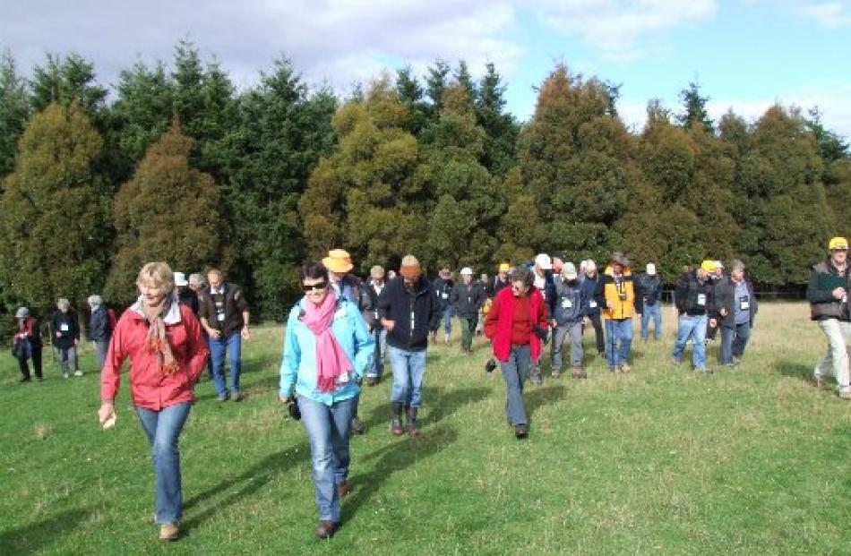 Some of those attending  the conference after viewing a stand of Douglas fir on Verterburn.