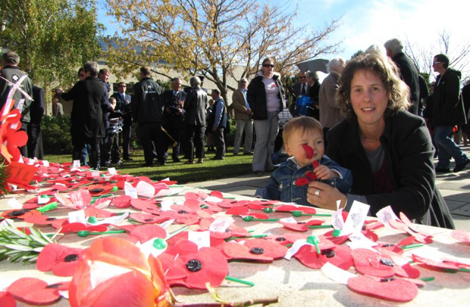Jaymerson Birtles (1) lays a poppy at his first Anzac Day service with mum Kim in Cromwell.