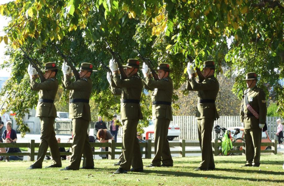 Soldiers from 4 O South, the Otago-Southland battalion, fire one of three volleys at the...