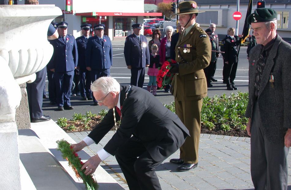 Waitaki Mayor Alex Familton lays a wreath at the Boer War monument, along with (from left) NZ...